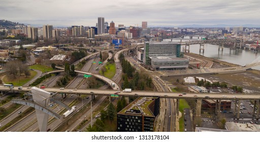 jumble of roads heads into and around Portland  the Willamette River flowing underneath