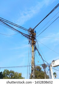 A jumbled up wires at a telephone tower