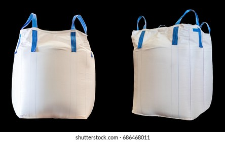 Jumbo bag of white sugar isolated on black background.