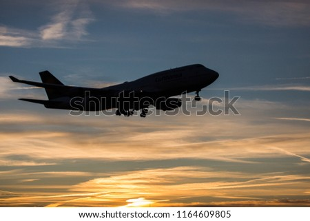 Jumbo Jet is ready for landing during sunrise