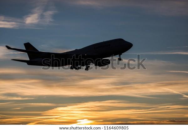 Jumbo Jet is ready for landing during sunrise
