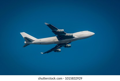 Jumbo jet takes off from airport.