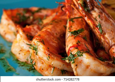 Jumbo shrimps (head on) with grilled lemon and garlic and citrus sauce