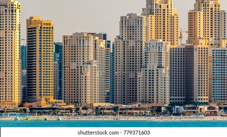 Jumeirah Beach Residence skyline at sunset time as seen from the palm jumeirah with sea timelapse. Dubai, United Arab Emirates