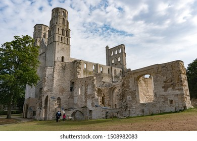 Jumieges, Normandy / France - 13 August 2019: tourists visit the ruins of the old abbey and Benedictine monastery at Jumieges in Normandy in France
