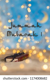 Jummah Mubarak! - Blessed Friday, Holy book of Quran and praying beads on it. Nice bokeh in the background