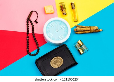 jummah mubarak time, holy book of muslims and rosary, siwak, perfume on colorful background