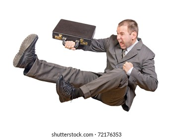 Jump businessman. Man in business suit jumps with a suitcase on a white background. Aggressive businessman with suitcase kicking leg in combat position. Fighting businessman jumps with kick his feet.