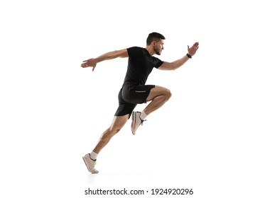 In jump. Caucasian professional sportsman training isolated on white studio background. Muscular, sportive man practicing. Copyspace. Concept of action, motion, youth, healthy lifestyle. - Shutterstock ID 1924920296