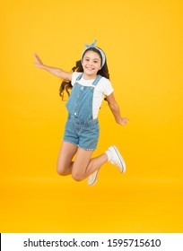 Jump of happiness. small girl jump yellow background. full of energy. Active girl feel freedom. Fun and relax. feeling free. carefree kid on summer holiday. time for fun. retro beauty in mid air.