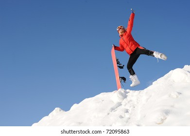 jump of happy young woman with snowboard