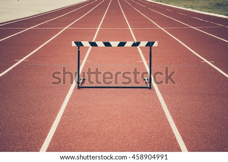 Jump hurdle on running track vintage