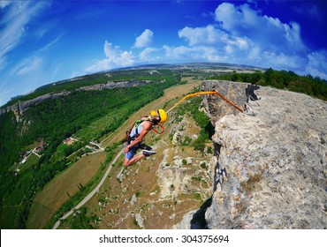 Jump off a cliff with a rope . Crimea. Kachy-Kalion.