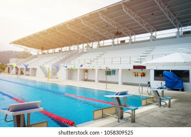 Jump platform for swimming in swimming pool and grandstand background