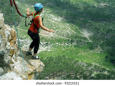 Jump with a rope from the cliff.