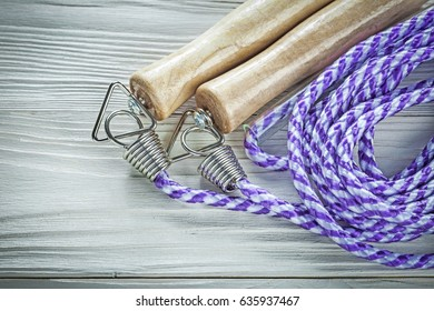 Jump rope on wooden board sports training concept.