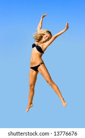 Jump of the young girl on a beach