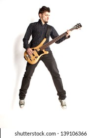 Jumping bass player on a white background
