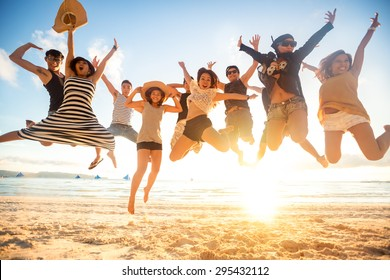 jumping at the beach, summer, holidays, vacation, happy people concept