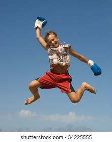 Jumping boy ( in the blue boxing glove)