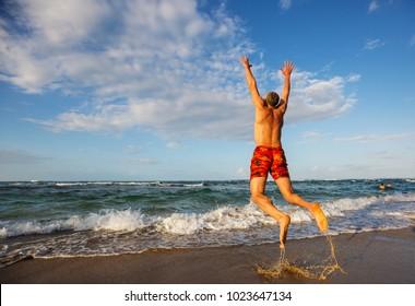 Jumping boy on the beach