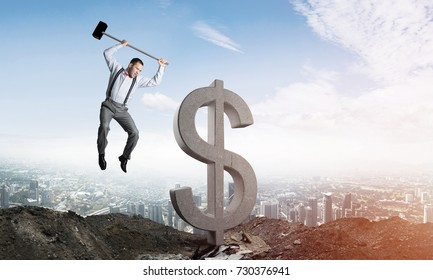 Jumping businessman crashing big dollar symbol with city view and sunlight on background. 3D rendering.