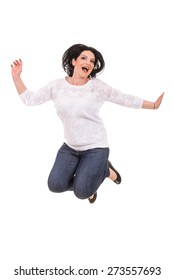 Jumping casual cheerful woman isolated on white background