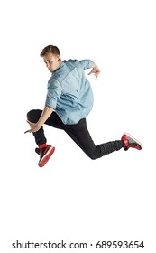 Jumping dancer man happy excited. portrait of young casual male model in jump isolated on white background.