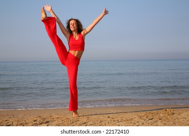 jumping fitness woman on beach