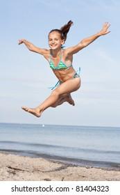 jumping girl at the beach