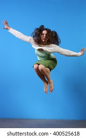 Jumping girl on blue background