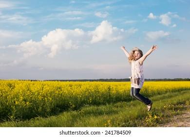 jumping girl in rape field