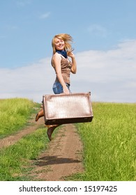 jumping girl with a suitcase