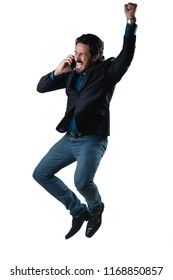 Jumping happy businessman celebrating great news with cell phone isolated against neutral background. Joy. .Jump.