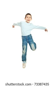 Jumping happy kid boy against white background