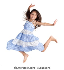 Jumping happy little girl, isolated on white