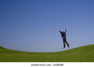 jumping high on a beautiful green and blue landscape