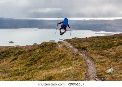 jumping Hiker with backpack on the Kungsleden