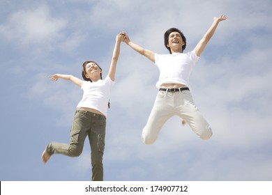 Jumping Japanese couple