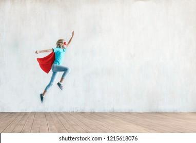 Jumping little girl in the studio