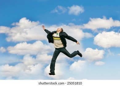 jumping man over sky background