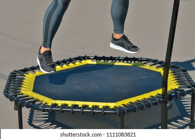 Jumping on an elastic trampoline.This exercise develops coordination.Legs get stronger.