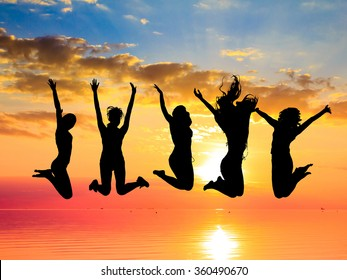 Jumping over Sunset Backlit Group
