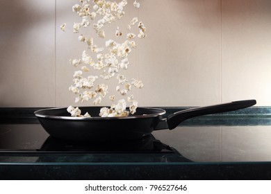 Jumping popcorn in a pan