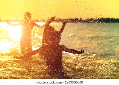 Jumping in the water. Kids have fun and splash in the water. Summer holiday concept