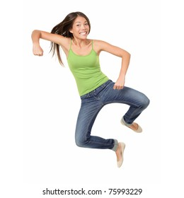 Jumping woman isolated. Funny jumping casual mixed race Asian Caucasian woman isolated on white background wearing reen tank top and jeans