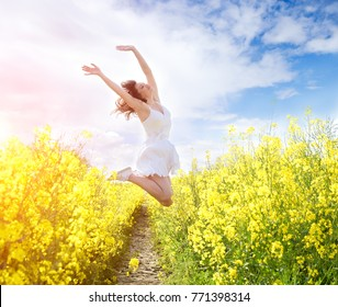 Jumping Woman in yellow field