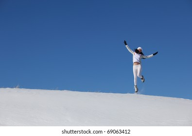 The jumping young girl on snow