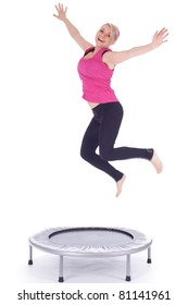 jumping young woman on the trampoline, white background