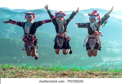 Jumping,Akha tribe jumping on the mountain in the morning, Chiang Rai Thailand